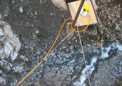 A radar gauge monitors the water level in a deep debris-flow channel.