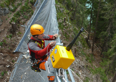Installation of one of over a hundred installed sensors in Ovella, Engadin Valley, Switzerland